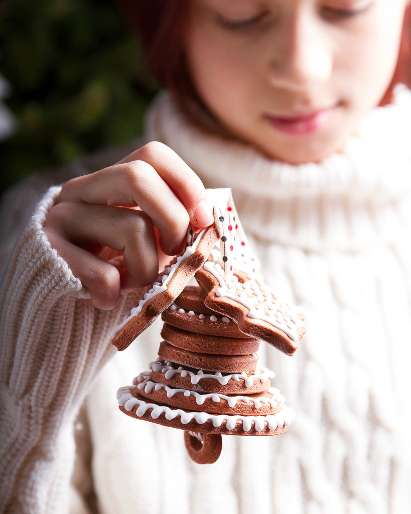 christmas bisquit bell in girl hand