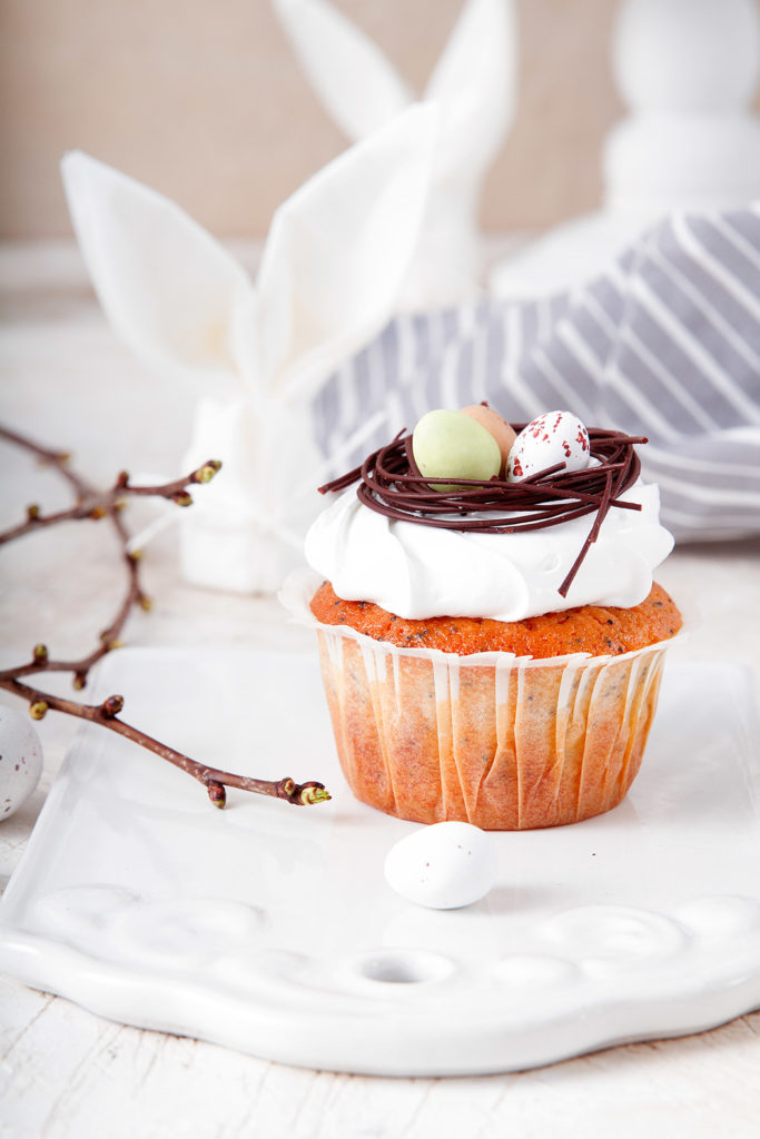 Easter muffins with chocolate nests and rabbit napkins